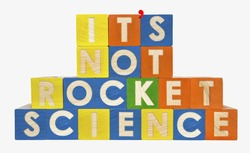 IT'S NOT ROCKET SCIENCE concept spelled with toy blocks. With apostrophe. Isolated.