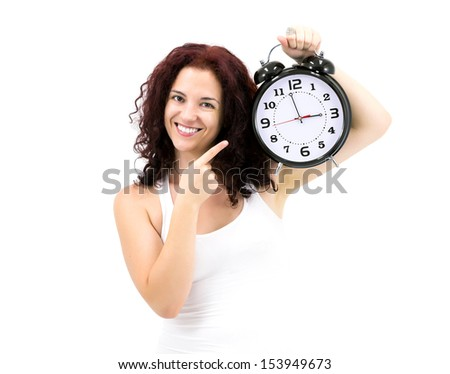 It's Time for... Adorable Smiling Young Woman holding huge heavy retro style clock. Studio shot on white background