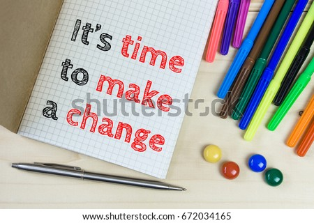 It's Time to make a change.  Text message on white paper and office supplies. Business concept. View from above, Top view