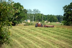 It's time to make the hay. It is summer and it is dry and that is the prime time for farmers to climb on their tractors and begin the hay baling process.