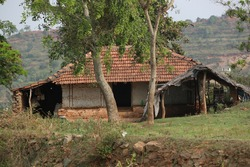 It shows an old house  which is made up of bricks and clay roofs in a beautiful small village at  Attappadi of palakad district,kerala.