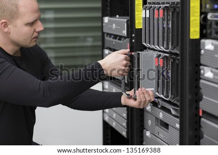 IT technician / engineer install / removes / replace a server in a data center.