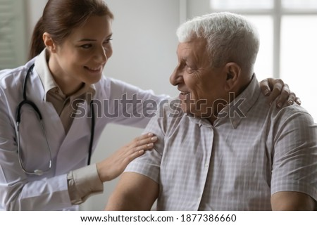 It will be all right. Friendly female doctor support encourage mature grey haired male patient. Caring young woman physician share optimism with sick old man ensure in favorable prognosis for disease