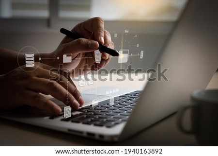 IT working on computer Business processes  Document Management System (DMS) progress planning and chart Stock photo ©