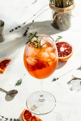 Italian Aperol Spritz cocktail with with bloody oranges, red bitter, dry white wine, soda, zest and ice. Summer drink.