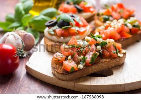 Italian Appetizer Bruschetta with roasted tomatoes, mozzarella cheese, garlic and herbs