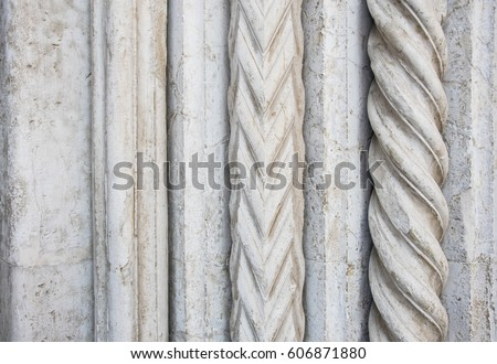 Italian architecture, detail of a Church central door stone carved #606871880