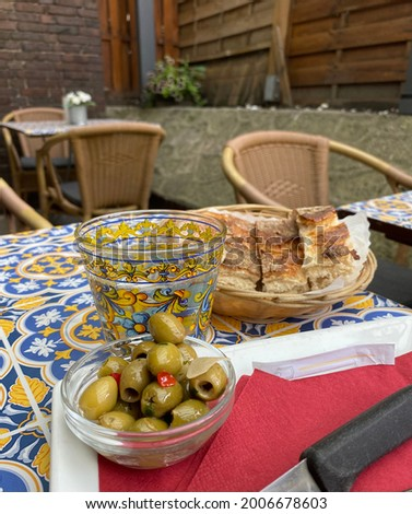 Italian bread and olives as an appetiser on the table Stock photo ©