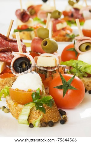 Italian bruschetta bread with olive, salami, cheese and tomato