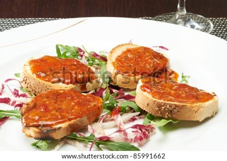 italian bruschetta seasoned with tomato and lettuce