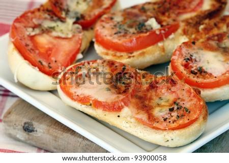Italian bruschetta with tomato and cheese, shallow dof