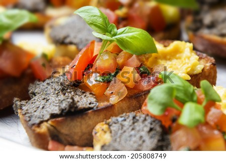 italian bruschetta with tomatoes, olive paste on a serving plate