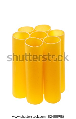 Italian cannelloni pasta tubes isolated over white background.