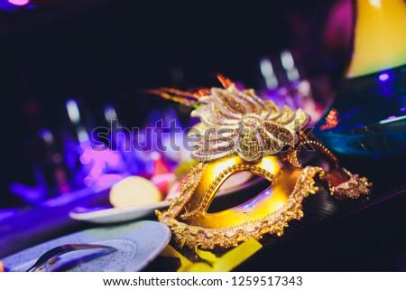 Italian carnival venetian golden mask. Mysterious event, party.