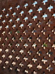 Italian cemetery, brick wall forming crucifixes.