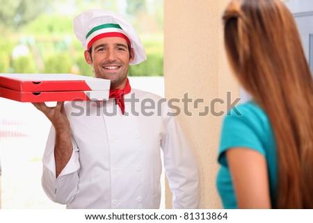 Italian chef bringing pizzas