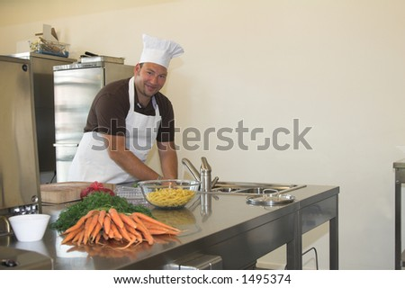 italian chef washing his hands prior to preparing the diner