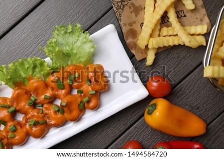 Italian Chicken Dynamite on wood table Stockfoto ©