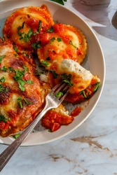 Italian chicken parmigiana dinner with ravioli and pink limeade