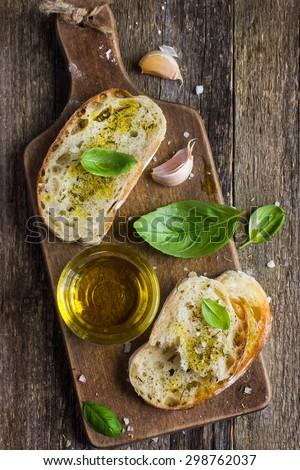 Italian ciabatta  bread with olive oil, top view