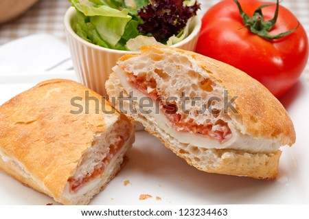 Italian ciabatta panini sandwich with parma ham and tomato