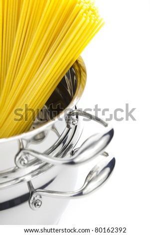 Italian cooking / saucepan with spaghetti / isolated on white