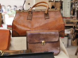 Italian craft market. Stall selling leather bags.