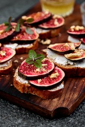 Italian crostini. Bruschetta  or ctostini with cottage cheese, figs and honey. Sandwich with figs and goat cheese.