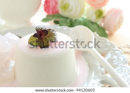 Italian cuisine, gourmet dessert Panna cotta with strawberry sauce