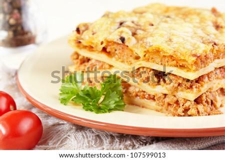Italian cuisine. Meat lasagna  on the served table