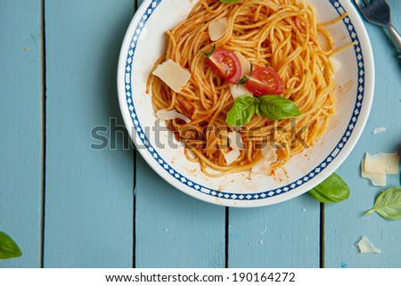 Italian cuisine, Mediterranean pasta with tomato sauce and cheese on a plate #190164272