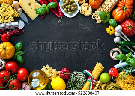 Shutterstock Italian cuisine. Vegetables, oil, spices and pasta on dark background