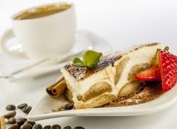 italian desert tiramisu with coffe and strawberry on white background