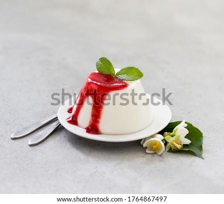 Italian dessert panna cotta vanilla with strawberry sauce on a light gray background Stock photo ©