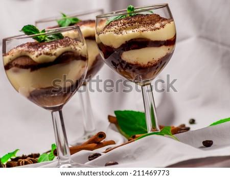 Italian dessert tiramisu with coffee and cinnamon