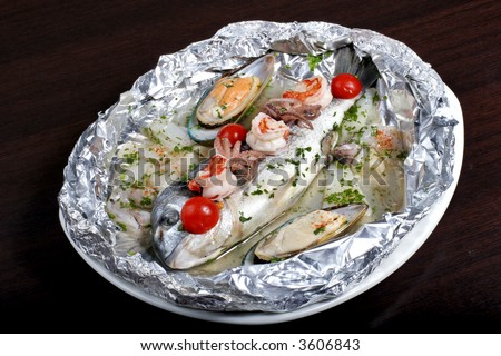 italian dish: dorado fish with seafood #3606843