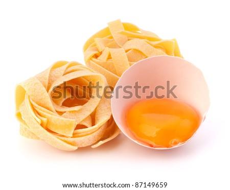 Italian egg pasta fettuccine nest isolated on white background