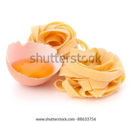 Italian egg pasta fettuccine nest isolated on white background