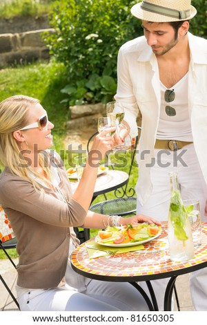 Italian elegant young people dining at outdoor restaurant terrace