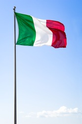 italian flag in front of blue sky