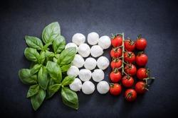 Italian flag made of fresh food on dark slate