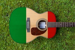 Italian flag motif painted on wooden steel string acoustic guitar