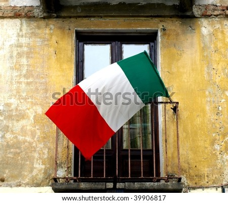 Italian flag on old balcony with grunge wall