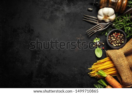 Italian food background. Italian cuisine. Ingredients on dark  background. Cooking concept. Cooking background