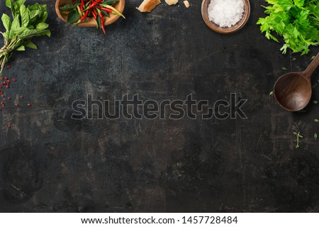 Italian food fresh ingredients like tomatoes, basil, cheese, spices, pasta on blackboard background, copy space