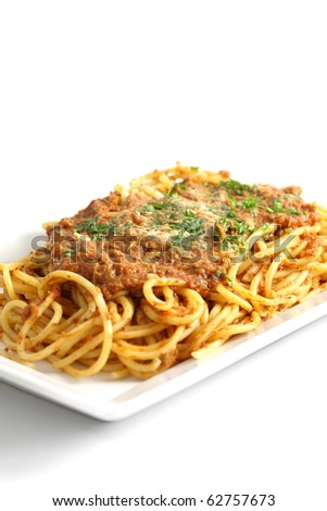 italian food : fresh spaghetti and tomato sauce with pork pasly in white background