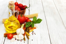 italian food ingredients on a old wooden background