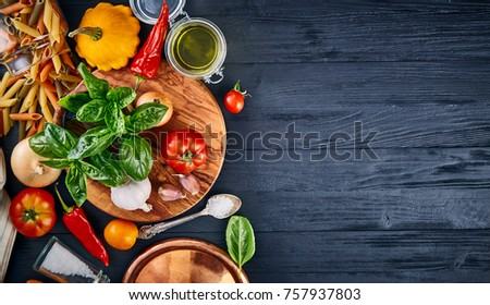 Italian food. Pasta basil tomato and olive oil on wooden black blackboard rustic style top view wiith copyspace. #757937803