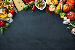 Italian food. Vegetables, olive oil, cheese and pasta on dark background