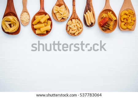 Shutterstock Italian foods concept and menu design. Various kind of Pasta Farfalle, Pasta A Riso, Orecchiette Pugliesi, Gnocco Sardo and Farfalle in wooden spoons setup on white wooden background with flat lay.